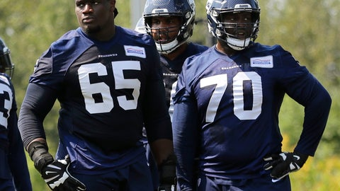 <p>               Seattle Seahawks offensive guard Germain Ifedi (65) stands on the field next to offensive guard Rees Odhiambo (70) during NFL football training camp, Monday, Aug. 6, 2018, in Renton, Wash. (AP Photo/Ted S. Warren)             </p>