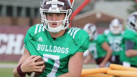 <p>               Mississippi State quarterback Nick Fitzgerald (7) runs through a blocking drill during an NCAA college football practice in Starkville, Miss., Friday, Aug. 10, 2018. (AP Photo/Jim Lytle)             </p>