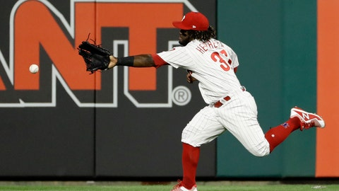 <p>               Philadelphia Phillies center fielder Odubel Herrera cannot reach a three-run double by Boston Red Sox's Mitch Moreland during the third inning of a baseball game Wednesday, Aug. 15, 2018, in Philadelphia. (AP Photo/Matt Slocum)             </p>