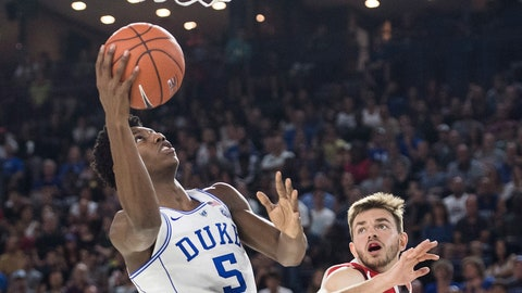 <p>               Duke's R.J. Barrett (5) goes up for two points as McGill Redmen's Noah Daoust defends during third quarter exhibition basketball action in Laval, Quebec, Sunday, Aug. 19, 2018. (Graham Hughes/The Canadian Press via AP)             </p>