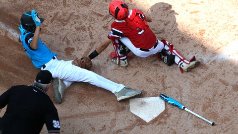 <p>               Canada catcher Andre Juco tags out Puerto Rico's Carlos De Jesus (17) at home during the fourth inning of Little League World Series baseball tournament game in South Williamsport, Pa., Wednesday, Aug. 22, 2018. (AP Photo/Tom E. Puskar)             </p>
