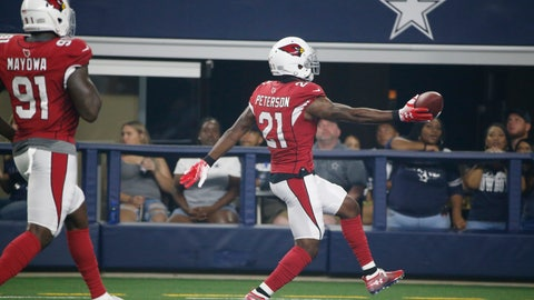 <p>               Arizona Cardinals defensive back Patrick Peterson (21) runs into the end zone with a touchdown followed by teammate Benson Mayowa (91) after an interception during the first half of a preseason NFL football game against the Dallas Cowboys in Arlington, Texas, Sunday, Aug. 26, 2018. (AP Photo/Michael Ainsworth)             </p>