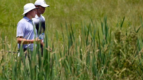 <p>               FILE - In this June 30, 2018, file photo, Tiger Woods, right, and Joel Dahmen, left, walks to the sixth tee during the third round of the Quicken Loans National golf tournament in Potomac, Md. Dahmen made it to the PGA Tour after a history of cancer in his family. (AP Photo/Nick Wass, File)             </p>