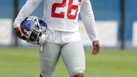 <p>               New York Giants running back Saquon Barkley works out individually while the rest of the team works out together during NFL football training camp, Tuesday, Aug. 21, 2018, in East Rutherford, N.J. (AP Photo/Julio Cortez)             </p>