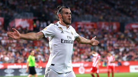 <p>               Real Madrid's Gareth Bale celebrates scoring his side's 3rd goal during the Spanish La Liga soccer match between Girona and Real Madrid at the Montilivi stadium in Girona, Sunday, Aug. 26, 2018. (AP Photo/Eric Alonso)             </p>