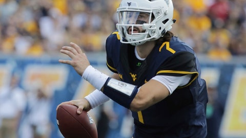<p>               FILE - In this Sept. 16, 2017, file photo, West Virginia quarterback Will Grier looks downfield during the team's NCAA college football game against Delaware State in Morgantown, W.Va. Grier threw for 3,490 yards last season, and his 34 TD passes in 11 games were the second-most in a single season for the Mountaineers. (AP Photo/Raymond Thompson, File)             </p>