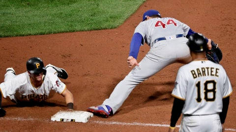 <p>               Pittsburgh Pirates' Kevin Newman, left, is doubled off first as Chicago Cubs first baseman Anthony Rizzo gets the throw from second baseman Javier Baez on a line-out by David Freese during the eighth inning of a baseball game, Friday, Aug. 17, 2018, in Pittsburgh. The Pirates challenged the call, but it was upheld. (AP Photo/Keith Srakocic)             </p>