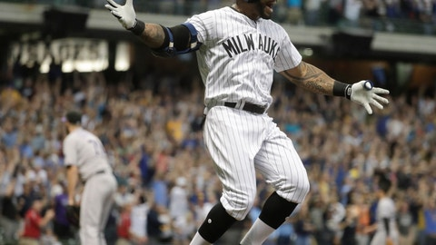<p>               Milwaukee Brewers' Eric Thames celebrates after hitting a three-run walk off home run during the ninth inning of a baseball game against the Colorado Rockies Friday, Aug. 3, 2018, in Milwaukee. The Brewers won 5-3. (AP Photo/Morry Gash)             </p>