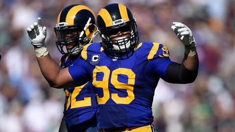 <p>               FILE - In this Sept. 18, 2016, file photo, Los Angeles Rams defensive tackle Aaron Donald tries to fire up the crowd during the team's NFL football game against the Seattle Seahawks at Los Angeles Memorial Coliseum in Los Angeles. Donald's teammates are finding silver linings to his absence while his second consecutive contract holdout with the Rams drags deep into training camp. Todd Gurley is grateful to be able to run plays in practice without the All-Pro defensive tackle bursting through the line and wrecking their work. Donald and the Rams are still talking about a long-term contract while the team prepares for a season of high expectations without him. (AP Photo/Kelvin Kuo, File)             </p>