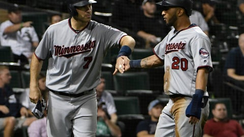 <p>               Minnesota Twins' Joe Mauer (7) and Eddie Rosario (20) celebrate after scoring against the Chicago White Sox during the ninth inning of a baseball game, Tuesday, Aug. 21, 2018, in Chicago. (AP Photo/David Banks)             </p>