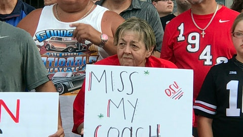 <p>               In this Monday, Aug. 6, 2016 photo, Ohio State fans listen to a speaker at a rally in support of coach Urban Meyer outside Ohio Stadium in Columbus, Ohio. Ohio State opened part of practice to the media on Tuesday, Aug 7, for the first time since coach Urban Meyer was put on paid leave, but other coaches and players remained off-limits for interviews. (AP Photo/Mitch Stacy)             </p>