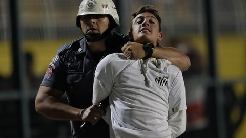 <p>               A police officer arrests a supporter of Brazil's Santos who was involved in a fight at the end of a Copa Libertadores soccer match between his team and Argentina's Independiente, in Sao Paulo, Brazil, Tuesday, Aug. 28, 2018. Independent won 3-0 on aggregate. (AP Photo/Andre Penner)             </p>