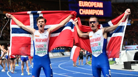 <p>               Norway's gold medal winner Jakob Ingebrigtsen, left, and silver medal winner Henrik Ingebrigtsen celebrate after the men's 5000-meter final at the European Athletics Championships at the Olympic stadium in Berlin, Germany, Saturday, Aug. 11, 2018. (AP Photo/Martin Meissner)             </p>