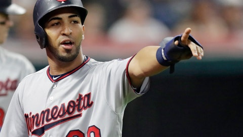 <p>               Minnesota Twins' Eddie Rosario points to Robbie Grossman after Grossman hit a two-run single in the seventh inning of a baseball game against the Cleveland Indians, Wednesday, Aug. 29, 2018, in Cleveland. Rosario scored on the play. (AP Photo/Tony Dejak)             </p>