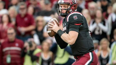 <p>               FILE -  In this Nov. 18, 2017, file photo, South Carolina quarterback Jake Bentley looks to pass during the first half of an NCAA college football game against Wofford in Columbia, S.C. Bentley has only one concern in fall camp, improving enough to make the Gamecocks contenders in the Southeastern Conference. The team's fate will rest on how well the junior with the big arm develops in South Carolina's faster-paced attack. (AP Photo/Sean Rayford, File)             </p>
