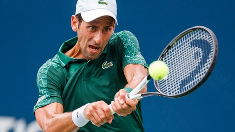 <p>               Novak Djokovic, of Serbia, returns a shot to Mirza Basic, of Bosnia, during the Rogers Cup men's tennis tournament in Toronto, Tuesday, Aug. 7, 2018. (Mark Blinch/The Canadian Press via AP)             </p>