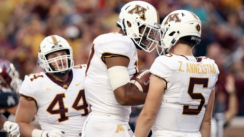 <p>               Minnesota tight end Seth Green (17) celebrates with quarterback Zack Annexstad (5) after the team scored a touchdown against New Mexico State during the first half of an NCAA college football game Thursday, Aug. 30, 2018, in Minneapolis. (AP Photo/Stacy Bengs)             </p>