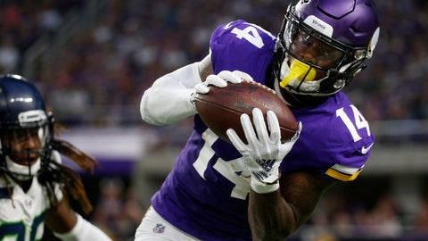 <p>               Minnesota Vikings wide receiver Stefon Diggs (14) catches a pass during the first half of an NFL preseason football game against the Seattle Seahawks, Friday, Aug. 24, 2018, in Minneapolis. (AP Photo/Bruce Kluckhohn)             </p>