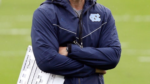 <p>               In this photo taken Friday, Aug. 3, 2018, North Carolina head coach Larry Fedora watches during an NCAA college football practice in Chapel Hill, N.C. (AP Photo/Gerry Broome)             </p>