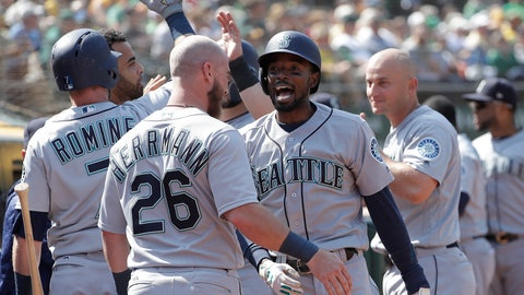 <p>               Seattle Mariners' Dee Gordon, center right, is congratulated by teammates after hitting a two-run home run against the Oakland Athletics during the 12th inning of a baseball game in Oakland, Calif., Wednesday, Aug. 15, 2018. (AP Photo/Jeff Chiu)             </p>
