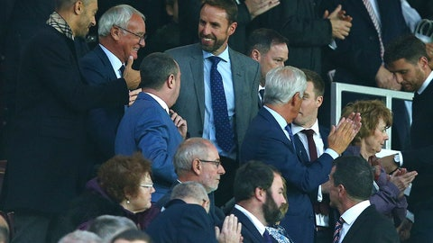 <p>               England soccer team manager Gareth Southgate, top center, and Claudio Ranieri, second left, take their seats for the English Premier League soccer match between Manchester United and Tottenham Hotspur at Old Trafford stadium in Manchester, England, Monday, Aug. 27, 2018. (AP Photo/Dave Thompson)             </p>