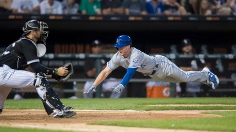 Aug 1, 2018; Chicago, IL, USA; Kansas City Royals right fielder Brett Phillips (14) slides into home plate to score against the Chicago White Sox during the fourth inning at Guaranteed Rate Field. Mandatory Credit: Patrick Gorski-USA TODAY Sports