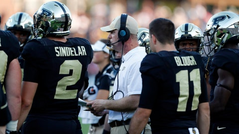 Sep 23, 2017; West Lafayette, IN, USA; Purdue Boilermakers coach Jeff Brohm on the sidelines with quarterback Elijah Sindelar (2) and quarterback David Blough (11) during a game against the Michigan Wolverines at Ross-Ade Stadium. Mandatory Credit: Brian Spurlock-USA TODAY Sports