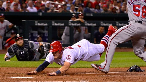 Aug 15, 2018; St. Louis, MO, USA; St. Louis Cardinals center fielder Harrison Bader (48) slides head first to score on a wild pitch by Washington Nationals starting pitcher Jeremy Hellickson (58) during the fifth inning at Busch Stadium. Mandatory Credit: Jeff Curry-USA TODAY Sports