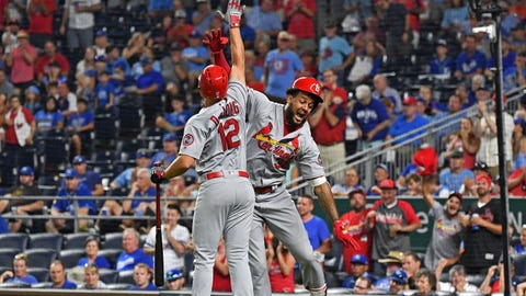 Aug 11, 2018; Kansas City, MO, USA; St. Louis Cardinals designated hitter Jose Martinez (38) celebrates with shortstop Paul DeJong (12) after hitting a two run home run during the ninth inning against the Kansas City Royals at Kauffman Stadium. Mandatory Credit: Peter G. Aiken/USA TODAY Sports