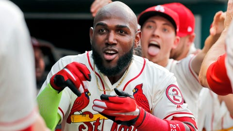 St. Louis Cardinals' Marcell Ozuna (23) celebrates after hitting a solo home run as teammate Luke Weaver jokes in the background during the second inning of a baseball game against the Milwaukee Brewers, Saturday, Aug. 18, 2018, in St. Louis. (AP Photo/Jeff Roberson)