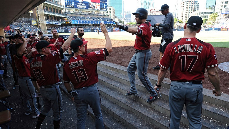 Late homers from Descalso, Pollock keep D-backs atop division