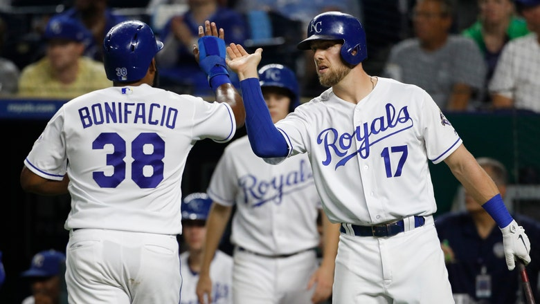 Clutch two-out hitting helps Royals split series with Jays after rain delay