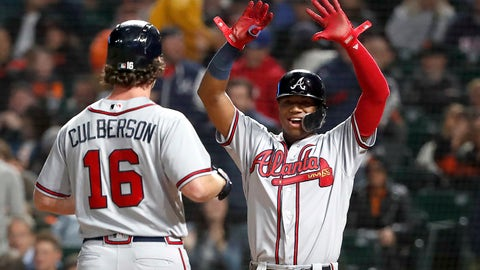 <p>               Atlanta Braves' Charlie Culberson (16) celebrates with teammate Ronald Acuna Jr., right, after hitting a two run home run against the San Francisco Giants during the fifth inning of a baseball game in San Francisco, Tuesday, Sept. 11, 2018. (AP Photo/Tony Avelar)             </p>