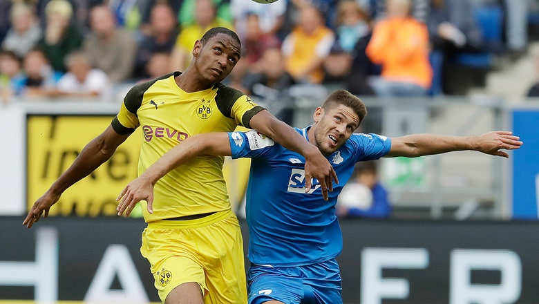 Pulisic rescues 10-man Dortmund again from first defeat