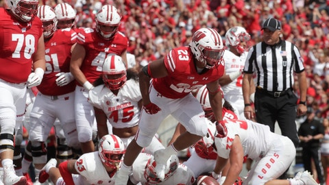 <p>               Wisconsin's Jonathan Taylor celebrates a touchdown run during the second half of an NCAA college football game against New Mexico Saturday, Sept. 8, 2018, in Madison, Wis. Wisconsin won 45-14. (AP Photo/Morry Gash)             </p>