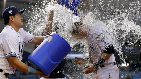 <p>               Tampa Bay Rays' Jake Bauers, right, gets doused with water by Tampa Bay Rays' Ji-Man Choi, of South Korea, left, and Willy Adames, center, after the Rays defeated the Oakland Athletics 7-5 during a baseball game, Saturday, Sept. 15, 2018, in St. Petersburg, Fla. (AP Photo/Chris O'Meara)             </p>