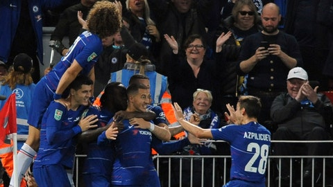 <p>               Chelsea's Eden Hazard, center, celebrates with teammates after scoring his side's second goal during the English League Cup soccer match between Liverpool and Chelsea at Anfield stadium in Liverpool, England, Wednesday, Sept. 26, 2018. (AP Photo/Rui Vieira)             </p>
