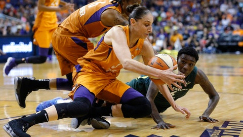 <p>               Phoenix Mercury guard Diana Taurasi, front, grabs a a loose ball next to Seattle Storm forward Natasha Howard, right, while Mercury guard Yvonne Turner (6) closes in during the first half of Game 3 of a WNBA basketball playoffs semifinal Friday, Aug. 31, 2018, in Phoenix. (AP Photo/Ross D. Franklin)             </p>