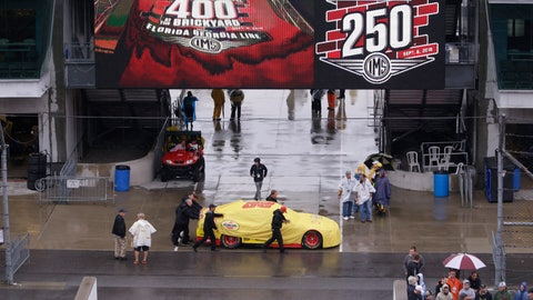 <p>               The car driven by NASCAR Cup Series driver Joey Logano (22) is pushed though the garage area as rain cancelled track activity for the Brickyard 400 auto race at Indianapolis Motor Speedway, in Indianapolis Saturday, Sept. 8, 2018. (AP Photo/AJ Mast)             </p>