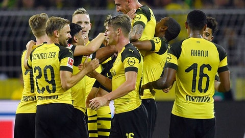 <p>               Dortmund's new forward Paco Alcacer, up, is celebrated by teammates after he scored his side's third goal at his debut during the German Bundesliga soccer match between Borussia Dortmund and Eintracht Frankfurt in Dortmund, Germany, Friday, Sept. 14, 2018. (AP Photo/Martin Meissner)             </p>