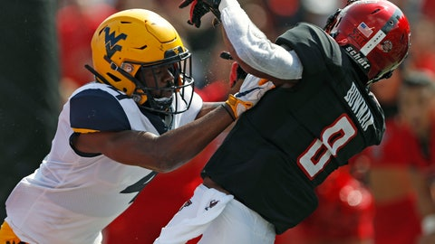 <p>               West Virginia's Josh Norwood (4) breaks up a pass meant for Texas Tech's De'Quan Bowman (8) during the first half of an NCAA college football game Saturday, Sept. 29, 2018, in Lubbock, Texas. (AP Photo/Brad Tollefson)             </p>