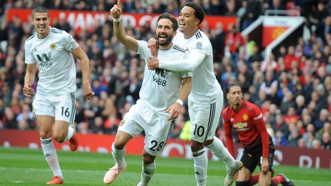 <p>               Wolverhampton Wanderers' Joao Moutinho, center left, celebrates after scoring his side's first goal during the English Premier League soccer match between Manchester United and Wolverhampton Wanderers at Old Trafford stadium in Manchester, England, Saturday, Sept. 22, 2018. (AP Photo/Rui Vieira)             </p>