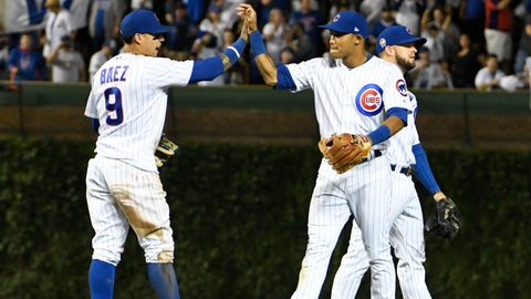 <p>               Chicago Cubs second baseman Javier Baez (9) and shortstop Addison Russell (27) celebrate their 3-0 win against the Milwaukee Brewers in a baseball game, Tuesday, Sept. 11, 2018, in Chicago. (AP Photo/David Banks)             </p>
