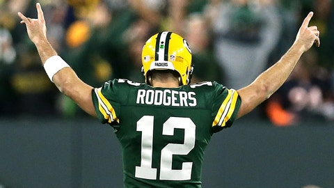 GREEN BAY, WI - SEPTEMBER 09:  Aaron Rodgers #12 of the Green Bay Packers reacts after throwing a touchdown pass to Randall Cobb #18 during the fourth quarter of a game against the Chicago Bears at Lambeau Field on September 9, 2018 in Green Bay, Wisconsin.  (Photo by Dylan Buell/Getty Images)