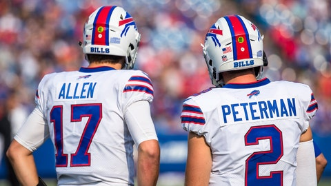 ORCHARD PARK, NY - AUGUST 26:  Josh Allen #17 and Nathan Peterman #2 of the Buffalo Bills speak with coaching staff during the preseason game against the Cincinnati Bengals at New Era Field on August 26, 2018 in Orchard Park, New York. Cincinnati defeats Buffalo 26-13 in the preseason matchup. (Photo by Brett Carlsen/Getty Images)