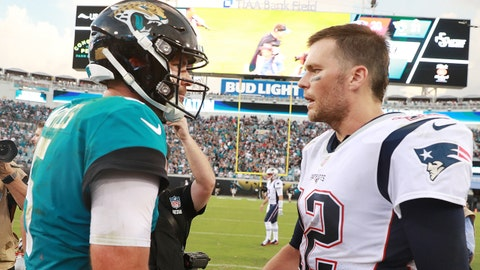 JACKSONVILLE, FL - SEPTEMBER 16:  Blake Bortles #5 of the Jacksonville Jaguars (L) greets Tom Brady #12 of the New England Patriots at midfield after theJaguars defeated Patriots 31-20 at TIAA Bank Field on September 16, 2018 in Jacksonville, Florida.  (Photo by Scott Halleran/Getty Images)