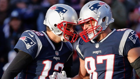 FOXBORO, MA - NOVEMBER 26: Tom Brady #12 reacts with Rob Gronkowski #87 of the New England Patriots after a touchdown during the third quarter of a game against the Miami Dolphins at Gillette Stadium on November 26, 2017 in Foxboro, Massachusetts. (Photo by Jim Rogash/Getty Images)