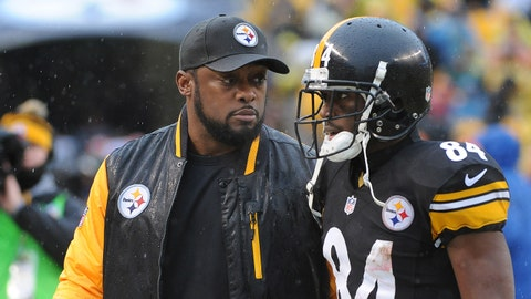 PITTSBURGH, PA - DECEMBER 29:  Head coach Mike Tomlin of the Pittsburgh Steelers talks to wide receiver Antonio Brown #84 as they walk off the field at the end of the first half during a game against the Cleveland Browns at Heinz Field on December 29, 2013 in Pittsburgh, Pennsylvania.  The Steelers defeated the Browns 20-7.  (Photo by George Gojkovich/Getty Images)