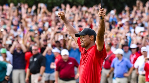 ATLANTA, GA - SEPTEMBER 23:  Tiger Woods celebrates his two stroke victory on the 18th hole green as fans watch behind him during the final round of the TOUR Championship, the final event of the FedExCup Playoffs, at East Lake Golf Club on September 23, 2018 in Atlanta, Georgia. (Photo by Keyur Khamar/PGA TOUR)