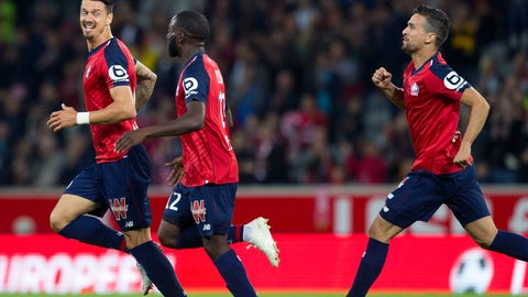<p>               Lille players celebrate after scoring during the French League One soccer match between Lille and Nantes at the Lille Metropole stadium, in Villeneuve d'Ascq, northern France, Saturday, Sept. 22, 2018. (AP Photo/Michel Spingler)             </p>